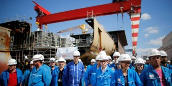 STX workers gather before a visit of French President Emmanuel Macron at the STX Les Chantiers de l'Atlantique shipyard site in Saint-Nazaire